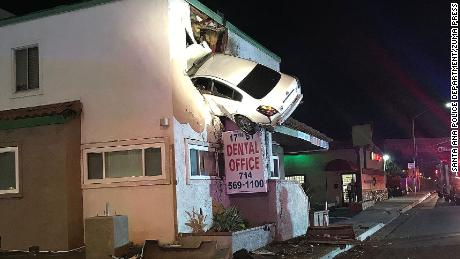 Jan 14, 2018 - Santa Ana, California, U.S. - A white sedan remains wedged into a dental office in Santa Ana on Saturday night. (Credit Image: © Santa Ana Police Department via ZUMA Wire)