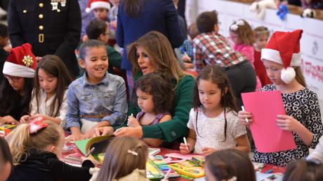 First lady Melania Trump helps children make Christmas cards with the Marine Corps Reserve Toys for Tots Campaign at Joint Base Anacostia-Bolling in Washington, DC on December 13, 2017 / AFP PHOTO / MANDEL NGAN