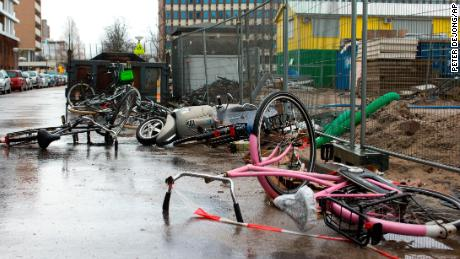 Bicycles and a scooter overturned by heavy winds lie in a street in Amsterdam, Netherlands, Thursday, Jan. 18, 2018.