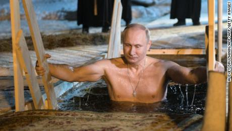 Russian President Vladimir Putin plunges into the icy waters of lake Seliger during the celebration of the Epiphany holiday in Russia's Tver region early on January 19, 2018. / AFP PHOTO / SPUTNIK / Alexey DRUZHININ        (Photo credit should read ALEXEY DRUZHININ/AFP/Getty Images)
