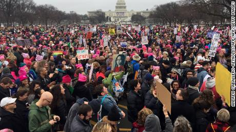 Demonstrators protest on the National Mall in Washington, DC, for the Women's march on January 21, 2017. Hundreds of thousands of protesters spearheaded by women's rights groups demonstrated across the US to send a defiant message to US President Donald Trump. / AFP PHOTO / Andrew CABALLERO-REYNOLDS        (Photo credit should read ANDREW CABALLERO-REYNOLDS/AFP/Getty Images)