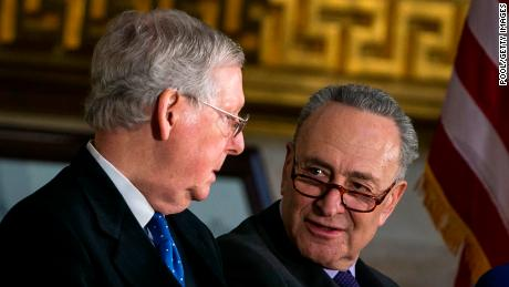 Senate Majority Leader Mitch McConnell (R-KY) (L) and Senate Minority Leader Chuck Schumer (D-NY) talk during the congressional Gold Medal ceremony for former Senate Majority Leader Bob Dole at the U.S. Capitol January 17, 2018 in Washington D.C.
