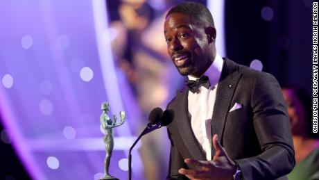 LOS ANGELES, CA - JANUARY 21:  Actor Sterling K. Brown accepts the award for 'Outstanding Performance by a Male Actor in a Drama Series' onstage during the 24th Annual Screen Actors Guild Awards at The Shrine Auditorium on January 21, 2018 in Los Angeles, California. 27522_010  (Photo by Christopher Polk/Getty Images for Turner Image)