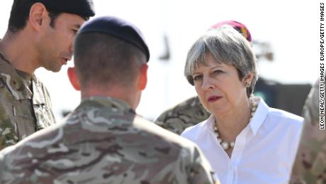 TAJI, IRAQ - NOVEMBER 29:  British Prime Minister Theresa May speaks with British soldiers at the Camp Taji military base on November 29, 2017 in Taji, Iraq. Theresa May has made a surprise visit to Iraq during a planned visit to the Middle East.  (Photo by Leon Neal/Getty Images)