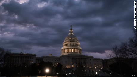 Lights shine inside the U.S. Capitol Building as day three of a partial government shutdown starts on Capitol Hill in Washington, Monday, Jan. 22, 2018. (AP Photo/J. Scott Applewhite)