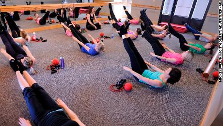 In this photo taken Wednesday Feb. 27, 2013, class members work out at Pure Barre in Montgomery, Ala. Pure Barre is a fusion workout that combines elements of several other methods, including yoga and Pilates. (AP Photo/Montgomery Advertiser, Mickey Welsh)