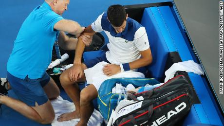 Novak Djokovic was visited by the trainer Monday.