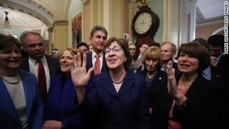 Sen. Susan Collins (R-ME), (C) celebrates with fellow Senators after the Senate voted and passed the a CR to reopen the government, at the U.S. Capitol on January 22, 2018 in Washington, DC. Senate leaders reached an arrangement to keep the government open until February 8.  (Photo by Mark Wilson/Getty Images)