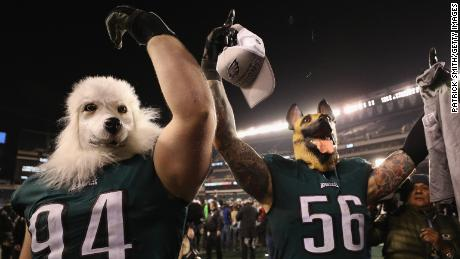 PHILADELPHIA, PA - JANUARY 21:  Beau Allen #94 and Chris Long #56 of the Philadelphia Eagles celebrates their teams win while wearing a dog masks over the Minnesota Vikings in the NFC Championship game at Lincoln Financial Field on January 21, 2018 in Philadelphia, Pennsylvania.  (Photo by Patrick Smith/Getty Images)