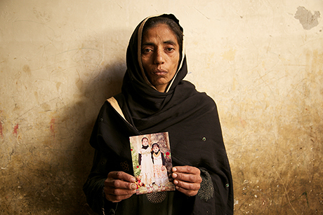 Aasia Bibi, 35, domestic worker. She is mother of Laiba Saleem, seen here holding a photograph of Laiba and her other daughter.