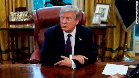 "President Donald Trump sits at the Resolute Desk after signing Section 201 actions in the Oval Office of the White House in Washington, Tuesday, Jan. 23, 2018. Trump says he is imposing new tariffs to ""protect American jobs and American workers."" Trump acted to impose new tariffs on imported solar-energy components and large washing machines in a bid to help U.S. manufacturers. (AP Photo/Carolyn Kaster)"