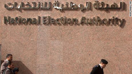 A policeman walks in front of the National Election Authority, which is in charge of supervising the 2018 presidential election, in Cairo, Egypt. (AP Photo/Amr Nabil)