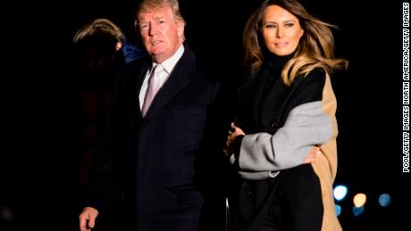 WASHINGTON, DC - JANUARY 15: President Donald Trump and First Lady Melania Trump return to the White House following a weekend trip to Mar-a-Lago, on the South Lawn of the White House on January 15, 2018 in Washington, D.C. (Photo by Kevin Dietsch-Pool/Getty Images)