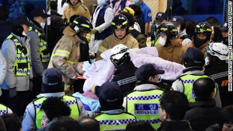 Rescue workers remove a survivor from the hospital fire Friday in Miryang, South Korea.