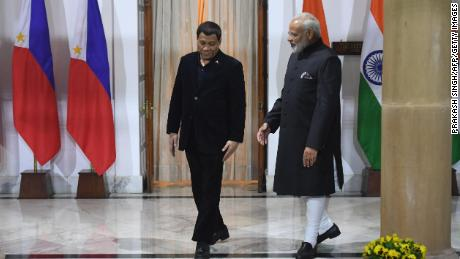 Indian Prime Minister Narendra Modi, right, welcomes the Philippine strongman this week in New Delhi.