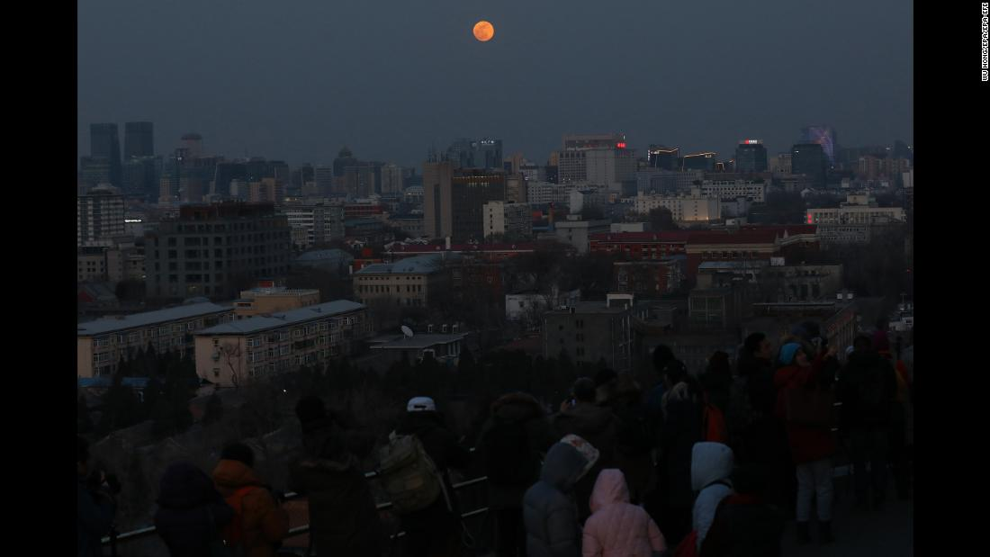 People gather to watch the supermoon in Beijing.
