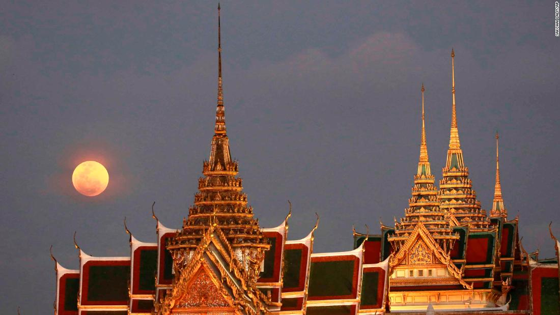 The supermoon is seen above the Grand Palace in Bangkok, Thailand.