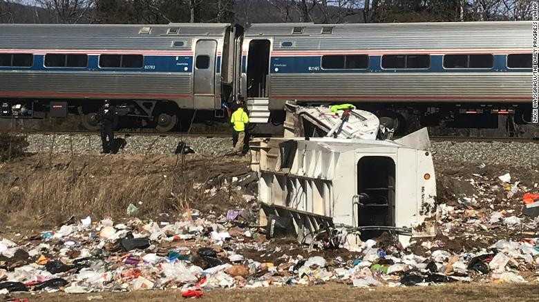 One dead after train hits garbage truck