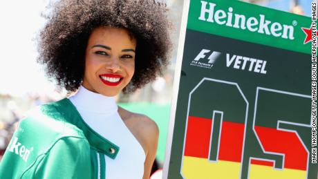 SAO PAULO, BRAZIL - NOVEMBER 12:  The grid girl of Sebastian Vettel of Germany and Ferrari looks on on the grid before the Formula One Grand Prix of Brazil at Autodromo Jose Carlos Pace on November 12, 2017 in Sao Paulo, Brazil.  (Photo by Mark Thompson/Getty Images)