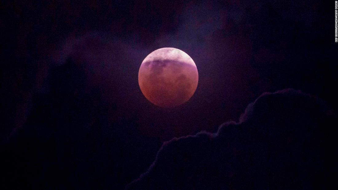 The moon is seen during a lunar eclipse in Jakarta, Indonesia.