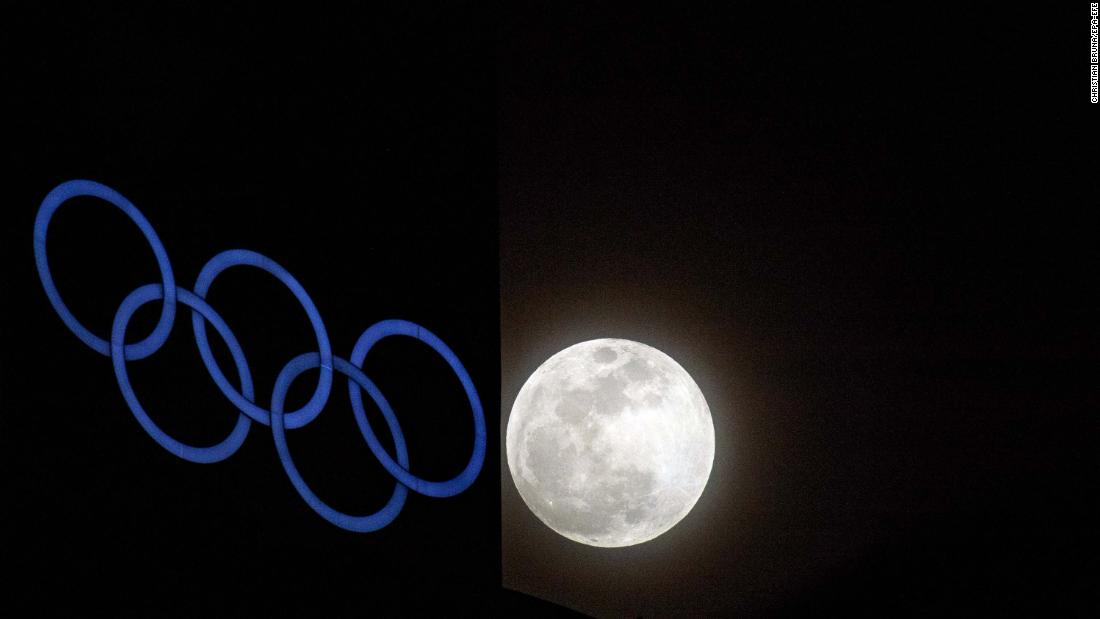 The supermoon rises over an Olympic rings installation at the Alpensia Ski Jumping Center, a venue of the upcoming Winter Olympic Games in Pyeongchang, South Korea.
