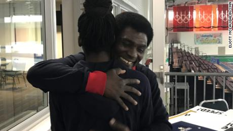 Kweku Biney embraces his daughter at the Utah Olympic Oval last month.