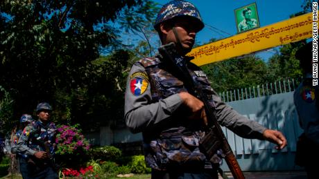 Police officers patrol in front of Suu Kyi's residence in Yangon on February 1, after a petrol bomb was hurled at it.