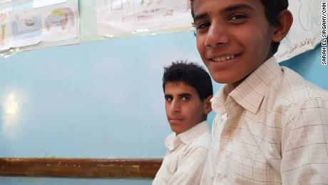 Saleh, right, says he used to drive rocket launchers to the front at the age of 13.