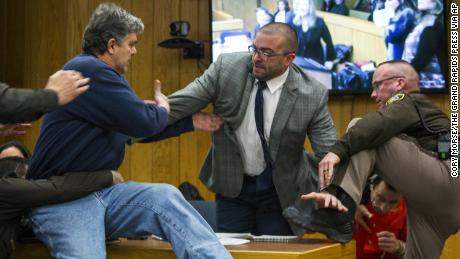 Randall Margraves father of three victims of Larry Nassar lunged at Nassar bottom right on Friday in Eaton County Circuit Court in Michigan