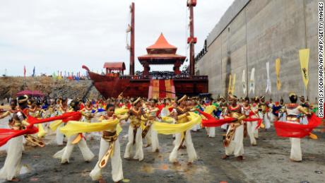 Sri Lankan dancers perform at the site of the Hambantota port during a ceremony marking the first phase of construction, August 15, 2010.
