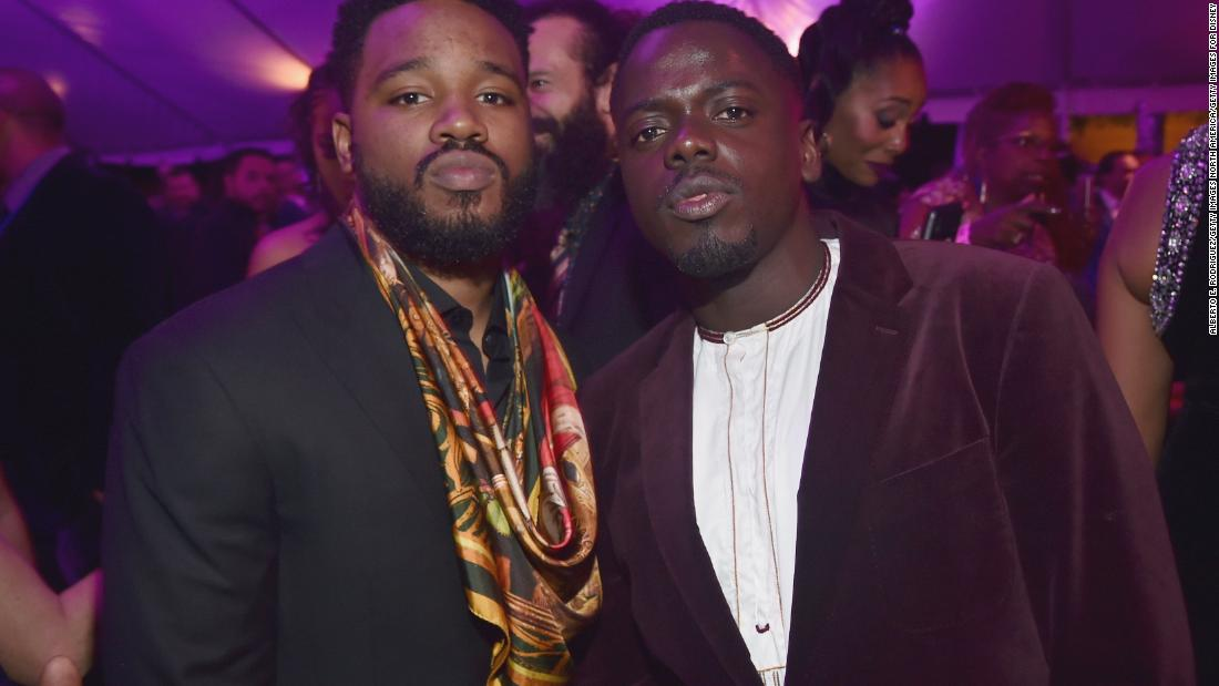 Writer/director Ryan Coogler (left) in a black suit with a colorful scarf and Get Out star Daniel Kaluuya.