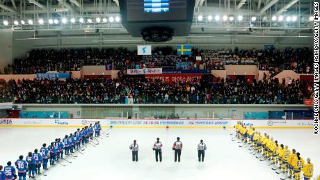 "Athletes listen to Korean folk song ""Arirang"" during the friendly match."