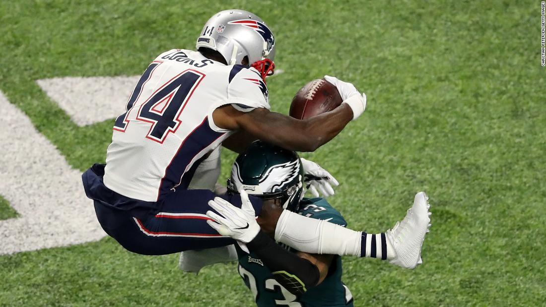 New England wide receiver Brandin Cooks is tackled by Philadelphia's Rodney McLeod as he tries to hurdle him during the second quarter.