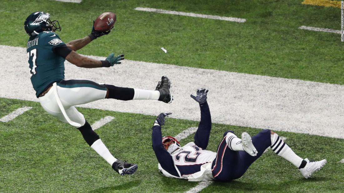 Philadelphia wide receiver Alshon Jeffery bobbles a pass that was intercepted by New England's Duron Harmon, not pictured.