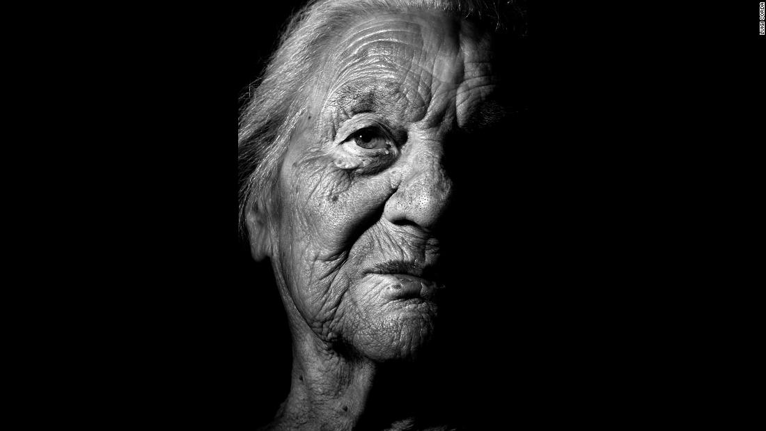 "For his ""100 Centenarians"" project, Luigi Corda spent two years photographing and interviewing people on the island of Sardinia. Pasqualina Schirru, born in 1907, worked in the mines. Cactus berries are among her favorite foods."