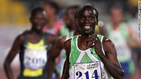 Doha, QATAR: Kenya's Eliud Kipchoge smiles as he crosses the finish line in 3,000 meter race at the IAAF Qatar Super Grand Prix in Doha, Qatar,11 May 2007. Kipchoge won the race, Jonas Cheruiyot and John Ebuja, his compatriots, took the second and third place.    AFP PHOTO/KARIM JAAFAR (Photo credit should read KARIM JAAFAR/AFP/Getty Images)