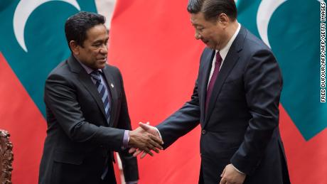 Maldives' President Abdulla Yameen shakes hand with China's President Xi Jinping after a signing ceremony at the Great Hall of the People in Beijing in December  2017.