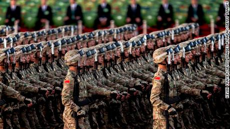 BEIJING, CHINA - SEPTEMBER 03:  Chinese soldiers march past Tiananmen Square before a military parade on September 3, 2015 in Beijing, China. China is marking the 70th anniversary of the end of World War II and its role in defeating Japan with a new national holiday and a military parade in Beijing. (Photo by Kevin Frayer/Getty Images)