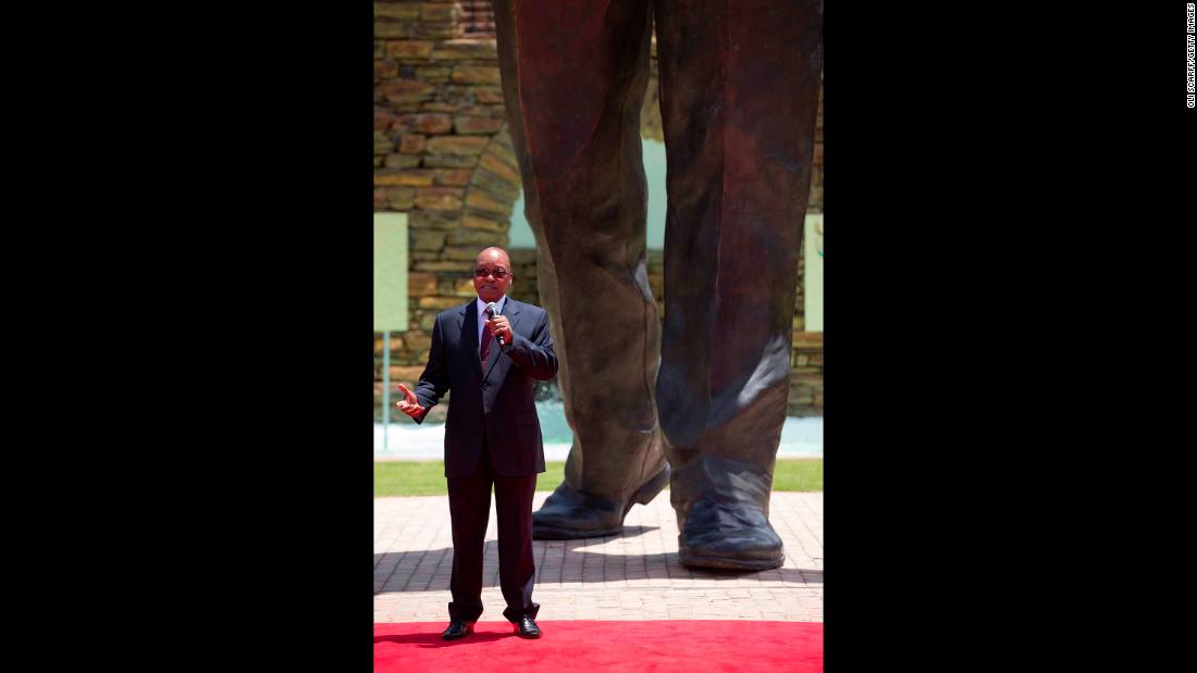Zuma unveils a giant statue of Mandela at the Union Buildings in Pretoria, South Africa, in December 2013.