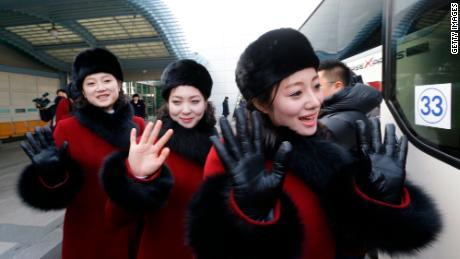 North Korean cheering squads wave upon arriving at the Korean-transit office near the Demilitarized Zone that divides the two Koreas Thursday.