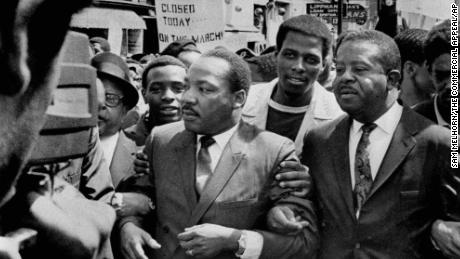 The Revs. Martin Luther King Jr. and Ralph Abernathy, right, lead a march on behalf of striking sanitation workers in Memphis in March 1968.