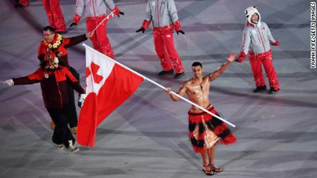 Tonga's Pita Taufatofua repeated his topless flag-bearing from Rio 2016.