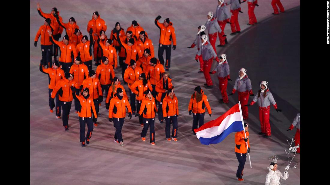 Dutch athletes enter the stadium.
