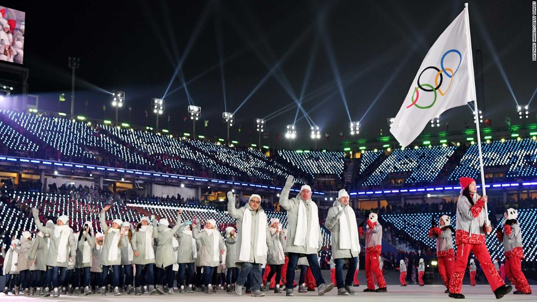 "Olympic athletes from Russia march under a neutral flag. Russia was banned from taking part in the Games after the International Olympic Committee found that the country had engaged in ""systemic manipulation"" of anti-doping rules."