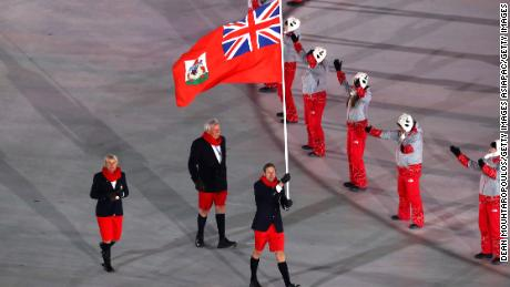Bare-chested Tongan flag-bearer wins Korean hearts