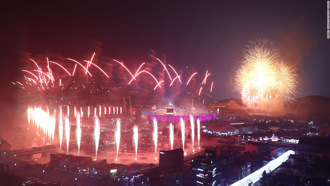 Fireworks explode over the stadium.