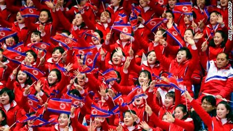 North Korean fans cheer, during the men's 1500 meters in the Gangneung Ice Arena at the 2018 Winter Olympics in Gangneung, South Korea, Saturday, February 10, 2018.
