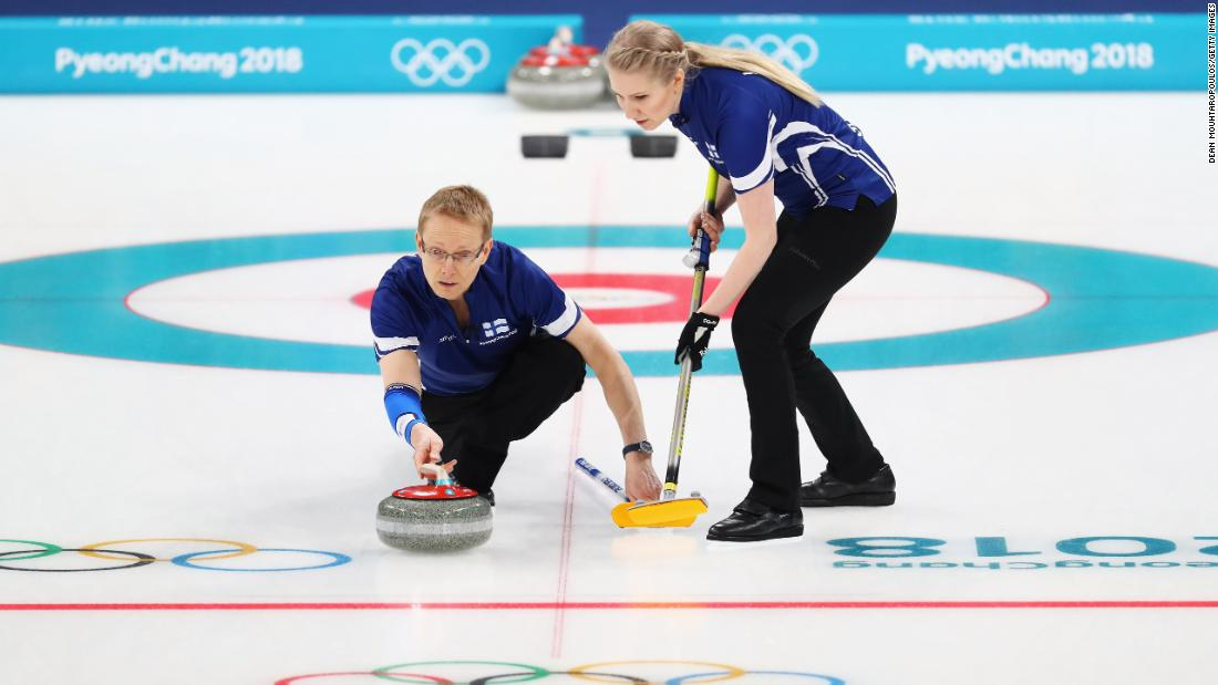 Tomi Rantamaeki and Oona Kauste of Finland compete in the mixed curling round robin against China.