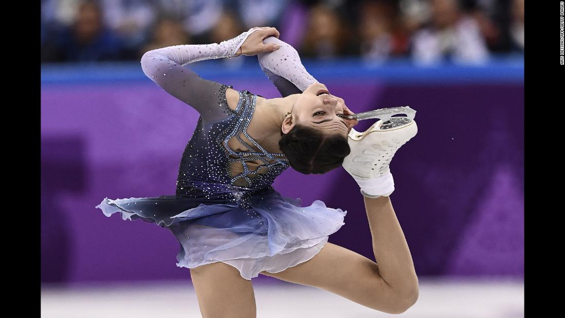 Russia's Evgenia Medvedeva competes in the figure skating single short program. The 18-year-old holds the world records for most points in both the short and long programs.