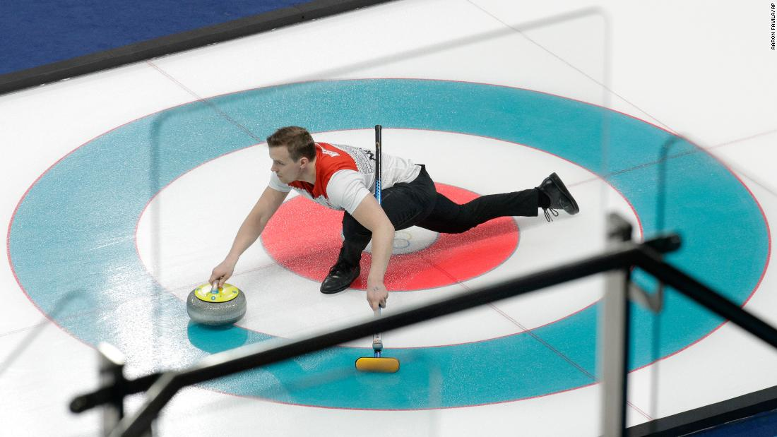 Norway's Magnus Nedregotten prepares to throw a stone during a mixed-doubles curling match.